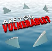 picture of fin  - Are You Vulnerable question in 3d letters and words surrounded by shark fins to ask if you are at risk of deadly force or danger from competition or criminals - JPG