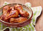 pic of chicken  - Roasted chicken drumsticks legs on wooden table - JPG