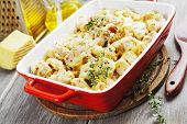 stock photo of chicken  - Casserole with cauliflower chicken and cheese in a ceramic pot - JPG