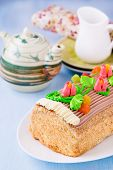 picture of yule  - Roulade cake decorated with colourful buttercream flowers - JPG
