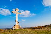 pic of cross hill  - religious wooden cross on a hill against the blue sky - JPG