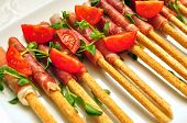 foto of collate  - grissini sticks bacon tomatoes and basil food aperitif - JPG