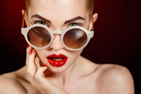 foto of freckle face  - Beautiful young model in sun glasses - JPG