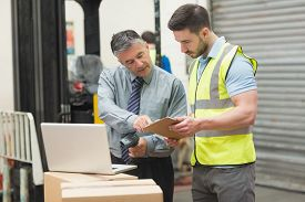 picture of warehouse  - Portrait of manual workers scanning package in the warehouse - JPG