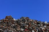 picture of scrap-iron  - Scrap metal yard with clear blue sky - JPG