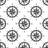stock photo of cartographer  - Ancient ornate compass roses seamless pattern in retro black and white style - JPG