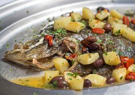 pic of flounder  - Baked flounder fish with potatoes olives and tomates cooked in oven - JPG