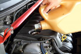 image of lube  - pouring oil machine to the car engine - JPG