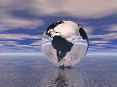 Globe In Ocean poster