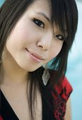 Attractive pretty impish cute Asian woman