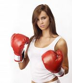 stock photo of boxing gloves  - Attractive Caucasian girl practicing boxing - JPG
