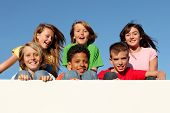 stock photo of children group  - group of kids holding placard with copy space - JPG