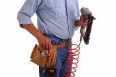 Carpenter Holding Nailgun