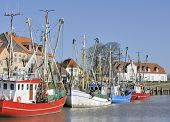 Colored fishing boats in historic harbor