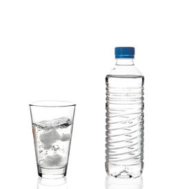 stock photo of bottle water  - Water bottle and a glass of water against white background - JPG