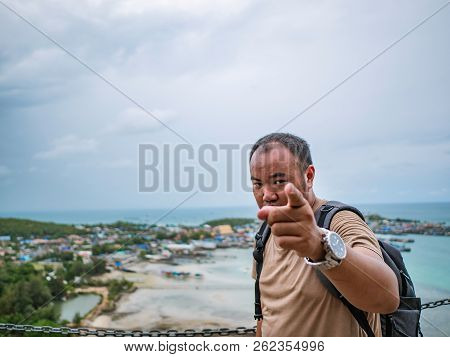 poster of Asisn Fat Backpacker Serious And Point Finger To The Camera On Top Of  Khao Ma Jor Pier With Idyllic
