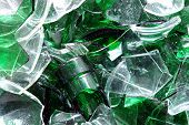 Background of clear and green glass broken into pieces