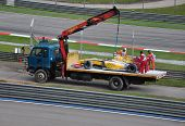 SEPANG, MALAYSIA - APRIL 4 : Vitaly Petrov's car was carried on a truck due to gearbox failure durin