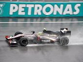 SEPANG F1 CIRCUIT, MALAYSIA - APR 3 : Hispania Racing F1 driver Bruno Senna speeding on wet track du