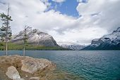 Beautiful Rocky Mountain lake in Alberta, Canada in autumn fall season and storm clouds