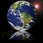 Globe  (NASA - Visible Earth) reflected on glass
