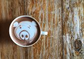 Cute Pig Face Latte Art Coffee In White Cup On Wooden Table ; Cute Latte Art In Your Cup , Love Eat  poster