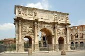 The arch of Constantine at the end of the palatine hill and the Roman Forum with the Colosseum behind