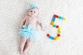 Adorable Baby Girl On White Background Wearing Turquoise Tutu Skirt. poster
