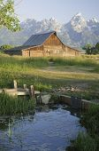 iconic scene of old Moulton Mormon wooden barn (circa 1880's) on Mormon Row in the Teton National pa