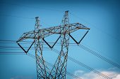 Close up metal tower of power Lines over clear blue sky poster