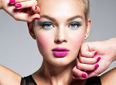 Beautiful woman face with blue makeup of eyes and pink nails. Glamour fashion model.  Fashion portra poster