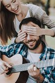 Disabled Man On Wheelchairs Playing Guitar In Park. Disabled Young Man. Woman On Wheelchair. Relaxin poster