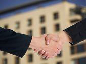 Handshake Handshaking and blured building in background