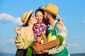 Family Gardening. Family Farm Concept. Parents And Daughter Farmers Celebrate Harvest Holiday. Famil poster