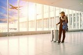 Single Woman And Traveling Luggage Standing In Airport Terminal Building poster