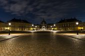 Amalienborg, The Palace And Residence In Copenhagen Of The Queen Of Denmark By Night. poster