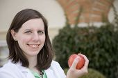 Smiling dietitian with an apple