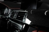 Close Up Of Air Condition Panel In Car Modern Interior With Red And Black Leather And A Carbon Panel poster