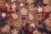 Christmas gingerbreads. Christmas decorations. Handmade cookies, fir branches with decorations on th poster