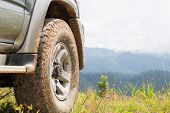 Offroad Car  On The Mountains, Offroad Travel  And Driving Concept. poster