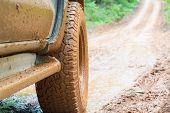 Off-road Tires, Dirty Offroad Car, Suv Covered With Mud On Countryside Road.  Offroad Travel  And Dr poster