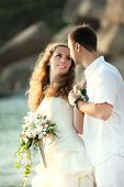 picture of wedding couple  - Bride and groom on the beach - JPG