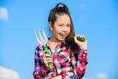 Girl Gardener With Hand Rake. Gardening And Harvesting Concept. Gardening Activity. Little Girl Gard poster