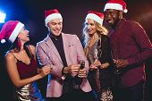 Multicultural Glamorous Boyfriends And Girlfriends In Santa Hats With Champagne On New Year Party poster