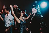 Happy Young People Dancing On New Year Party. Happy New Year. People Have Fun. Indoor Party. Celebra poster