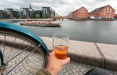 Cityscape With Riverboat, Old Buildings And Relaxed Visitor Of Copenhagen With Beer In Hand, Denmark poster