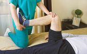 Physiotherapist Doing Exercises For Leg Recovery To Immobilized Male Patient At Home. People, Health poster