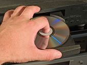 inserting blu-ray dvd disk in player