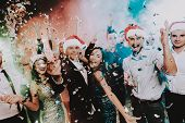 People In Santa Claus Cap Celebrating New Year. Happy New Year. People Have Fun. Indoor Party. Celeb poster