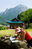 groups of travelers examining map in the Buddhist Sinheungsa Temple in Seoraksan National Park, Sout